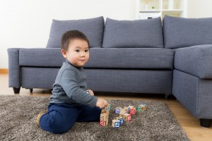 image of boy playing on rug for Sydney residential rug cleaning service from Green Clean Carpet Cleaning